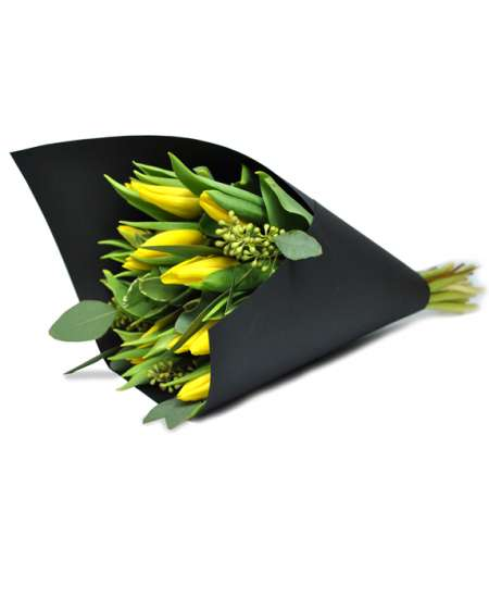 Bouquet of yellow tulips in black paper