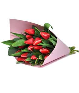 Bouquet of red tulips in pink paper