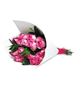 Bouquet of pink roses in white craft paper