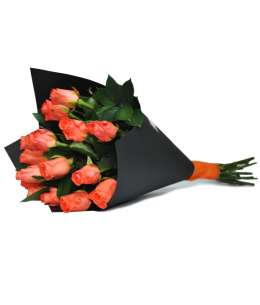 Bouquet of orange roses in black craft paper