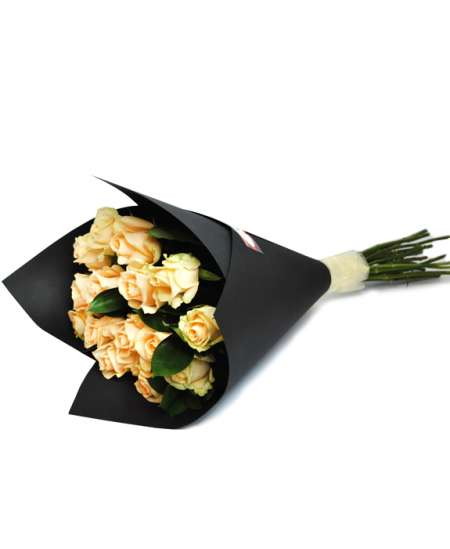 Bouquet of beige roses in black paper