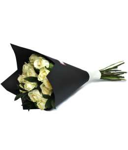 Bouquet of white roses in black craft paper