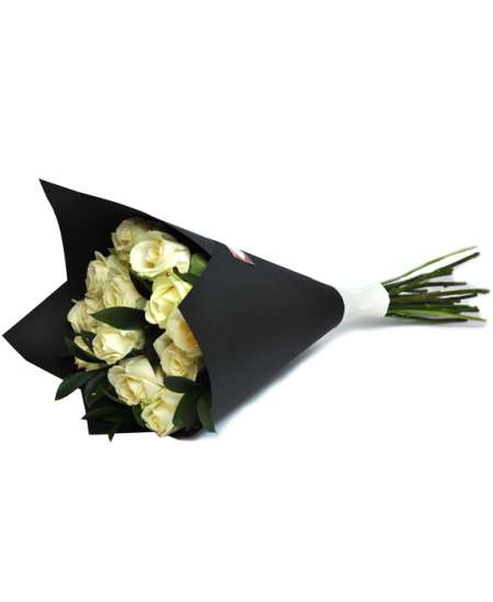 Bouquet of white roses in black paper