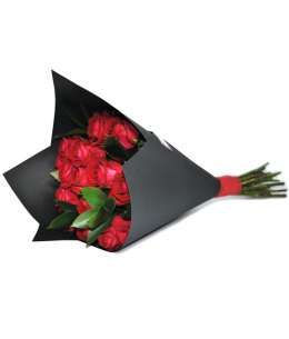 Bouquet of red roses in black craft paper