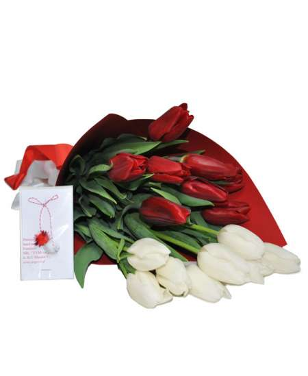 Bouquet of red and white tulips in craft paper