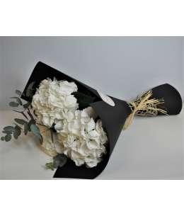 Bouquet of 3 white hydrangeas in black paper