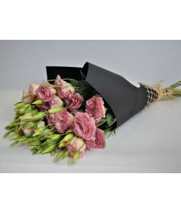 Bouquet of 11 eustome pink in black kraft paper