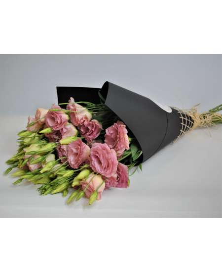 Bouquet of eustome pink in black kraft paper
