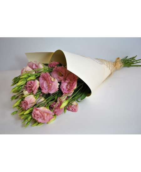 Bouquet of 11 pink eustomers in cream kraft paper